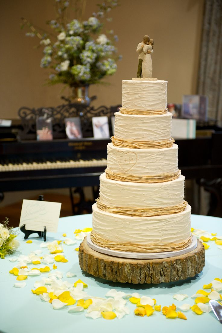 """rustic Wedding Cakes - yes to the frosting application and the tree base, no to the raffia and the cake topper (the """"carving"""" is a cute touch)"""
