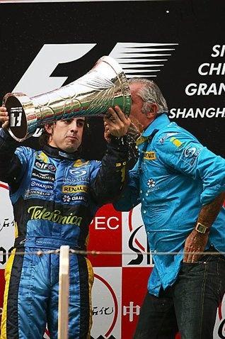 Fernando Alonso (ESP) Renault and Flavio Briatore (ITA) Renault Team Principal on the podium.   Formula One World Championship, Rd19,  Chinese Grand Prix, Race, Shanghai, China, 16 October 2005
