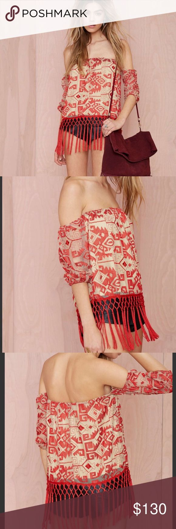 Nasty Gal Line & Dot Other World Embroidered Top Get ready to look like you just got back from the ultimate tropical vacation. The Other World Top is made in a nude mesh and features all-over red embroidery, stretch band at off-the-shoulder neckline, and fringe at hem-- perfect for showing off those moves. Partially lined, side zip closure. We love it teamed up with strappy nude heels and a wide open dance floor. By Line and Dot. Polyester/Nylon Runs true to size. Dry clean. Imported. Color…