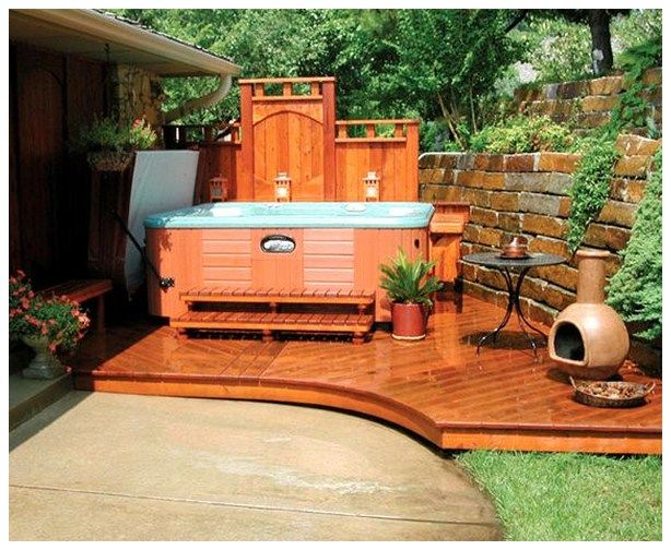 Hot Tub Ideas Backyard this version is built into a raised stone garden bed and is covered by a curved Hot Tub Design And Landscaping Backyard Patio Ideas