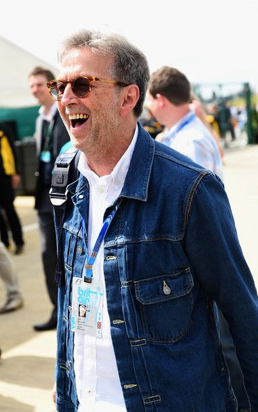 Eric Clapton Photos Photos - Eric Clapton walks down the paddock during the British Formula One Grand Prix at Silverstone Circuit on July 6, 2014 in Northampton, United Kingdom. - F1 Grand Prix of Great Britain