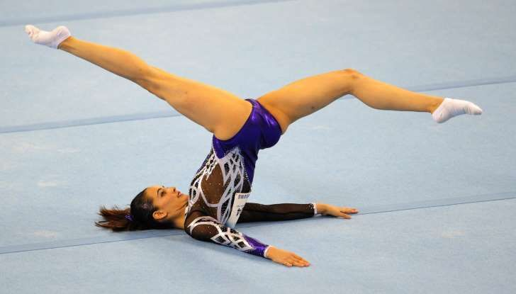 Farah Ann Abdul Hadi of Malaysia competes during the women's floor excercise routine final at the 28th Southeast Asian Games (SEA Games) in Singapore on June 10, 2015. She was criticized in her own country of Malaysian for revealing too much of herself (too much of her genitalia was showing)