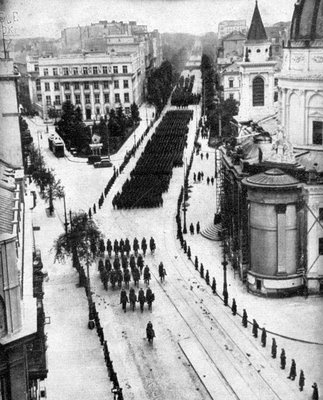 On October 5, 1939, Adolf Hitler flew to Warsaw, Poland to take the salute at the Grand Review of his victorious troops. The route was carefully chosen to avoid those parts of the city that had been devastated by aerial bombardment, and the streets were lined by Nazi troops to keep the crowds in check. This precaution, however, seemed unnecessary since Warsaw's population stayed indoors, and the procession made its way through almost deserted streets.