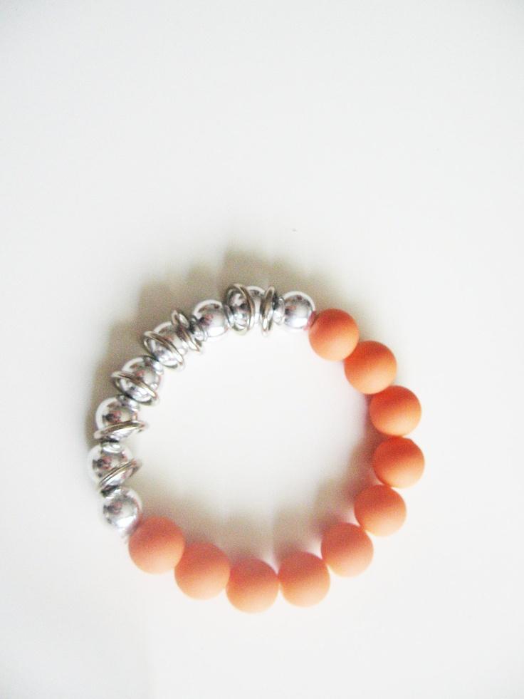 Orange matte beaded bracelet- orange and silver beads- funky bracelet- neon orange. $19.00, via Etsy.