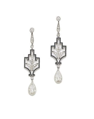 A pair of Art Deco enamel and diamond pendant earrings, circa 1925. Each of black enameled openwork architectural design, with foliage decoration, set with cushion-shaped and single-cut diamonds, suspending a pear-shaped diamond drop, diamonds approx. 4 cts total.
