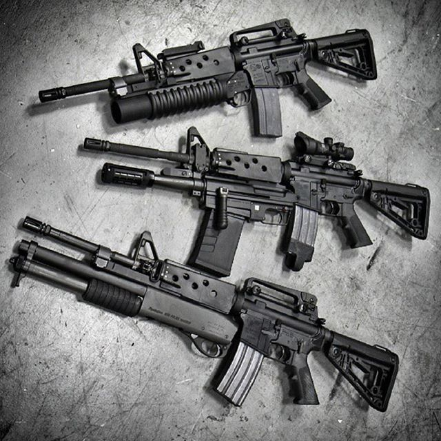 ARs with 3 different under mount attachments. Top is 40mm grenade launcher, middle is shotgun with side charging, and bottom is pump action shotgun.