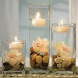get some floating candles from walmart and put them in a glass with water and whatever else you want in it.