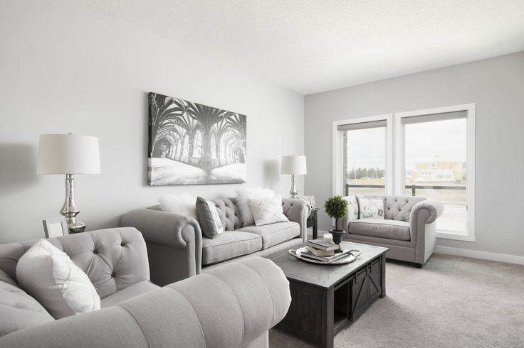 Open main floor layout in Creations by Shane Homes Samara Showhome in Midtown in Airdrie #FamilyRoom #LivingRoom