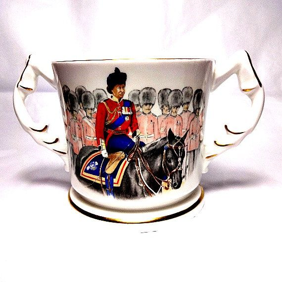 Rather special Aynsley bone china loving cup commemorating the 60th Birthday of The Queen. She is riding her favourite horse, Burmese, for the Trooping the Colour Horse Guards Parade. Burmese retired after this event and this is the last Trooping the Colour that Her Majesty rode on horseback.