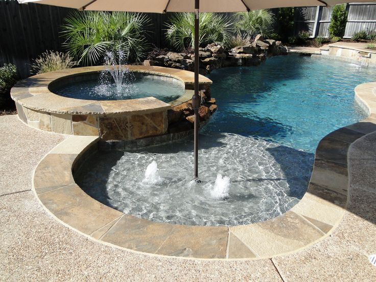 Tanning ledge gusher fountains raised spa backyard for Raised swimming pool designs