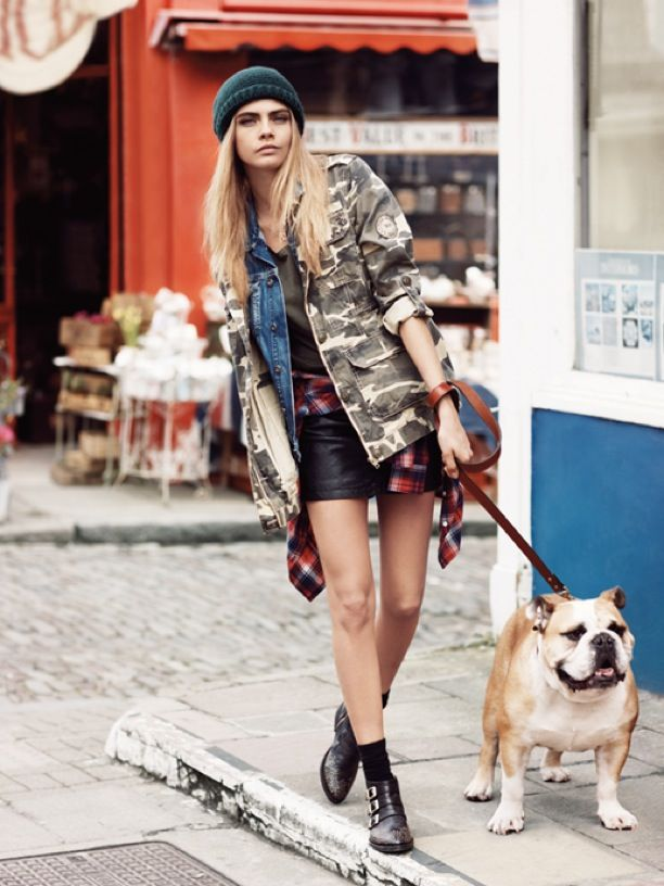 Cara Delevingne and George Alsford Pepe Jeans FW 2013 Ad Campaign Photographer Josh Olin London Cool Beanie Hat Camo Print Camouflage Jacket Jean Jacket Denim Jacket Plaid Shirt Tied Around Waist Leather Skirt Buckled Ankle Boots Walking Dog