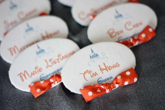 Instead of boutonnieres for the men! Way too cute!<--can I PLEASE just start planning a Disney themed wedding for you?  it just sounds like RIDICULOUS amounts of fun...