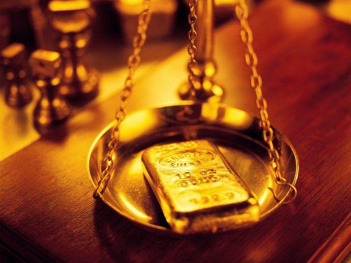 PT. Rifan Financindo Berjangka, Harga emas berakhir turun tipis pada akhir perdagangan Jumat dinihari setelah dollar AS naik tipis namun
