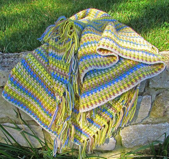 Crochet this gorgeous afghan blanket in beautiful spring shades - easy and quick to make, it's ideal for beginners. #crochet #crochetblanket #crochetafghan #crochetthrow #beginnercrochet