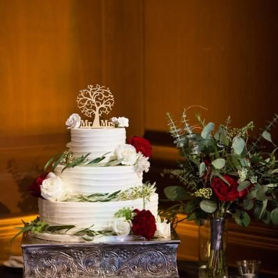 Three teir round white wedding cake with overlapping icing and a Mr and Mrs wooden tree cake topper   David DeDios Photography   villasiena.cc