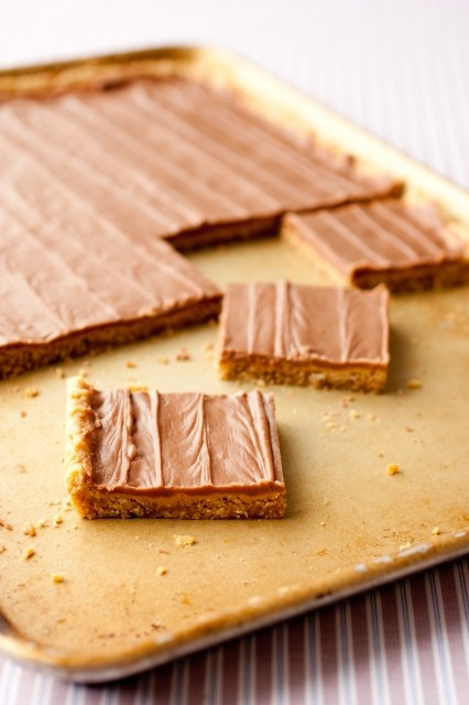 Peanut Butter Bars - These things are outrageously addictive. They make a cookie sheet full so have a few friends close by to share with or you won't know where to stop!
