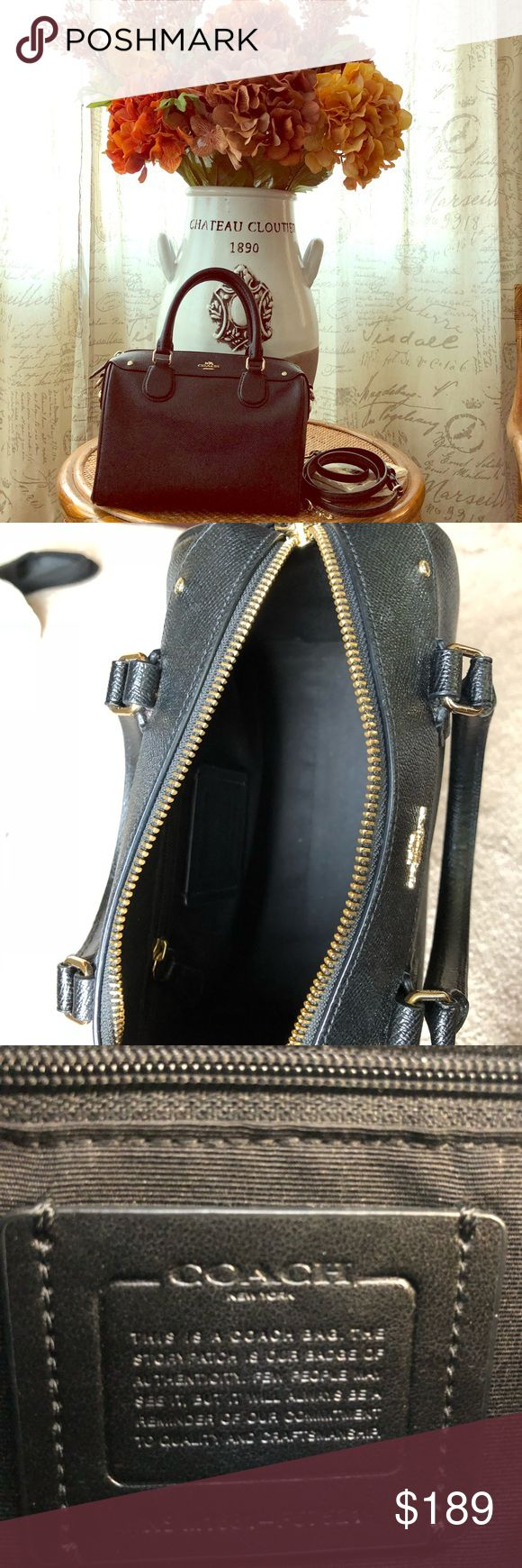 Coach purse Like new. Just bought it this year. Gorgeous black Coach purse. It seems tiny but ALOT can fit. It has two small compartments on the sides. Includes an adjustable & detachable strap. Feel free to ask questions. Coach Bags Mini Bags