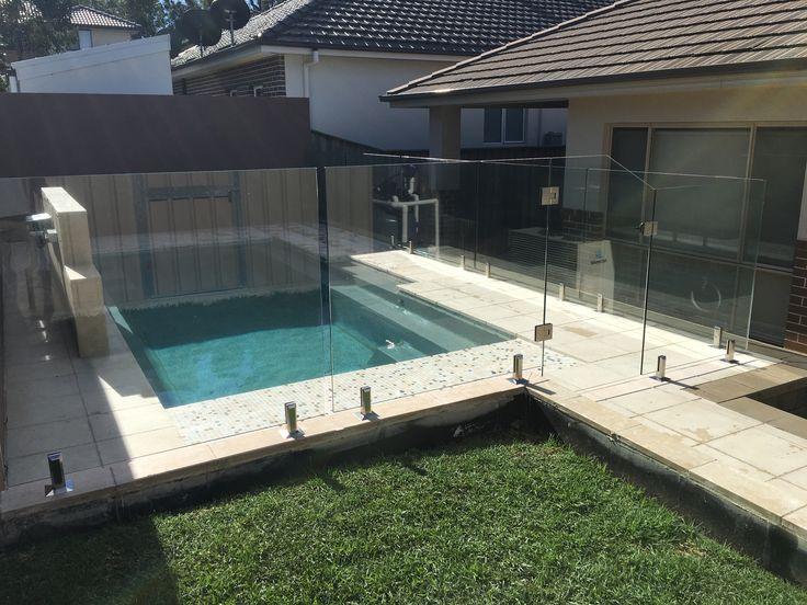 A Custom install in West Hoxton that needed a Custom Glass Gate. Polaris slow close hinges and Square brushed Spigots. #poolfencing #framelessglass #customglass #customfencing #backyardpool