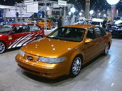 1994 ford taurus sho. Hate the color, but this is the cleanest 2nd gen sho I ever seen. Love the stance & the wheels too.