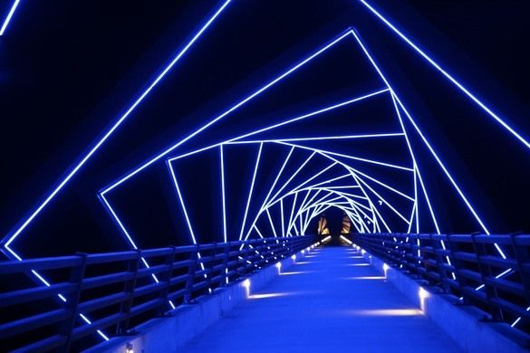 Half a mile long and 13 stories high, the bridge over the Des Moines River Valley lights up the wide night vista.