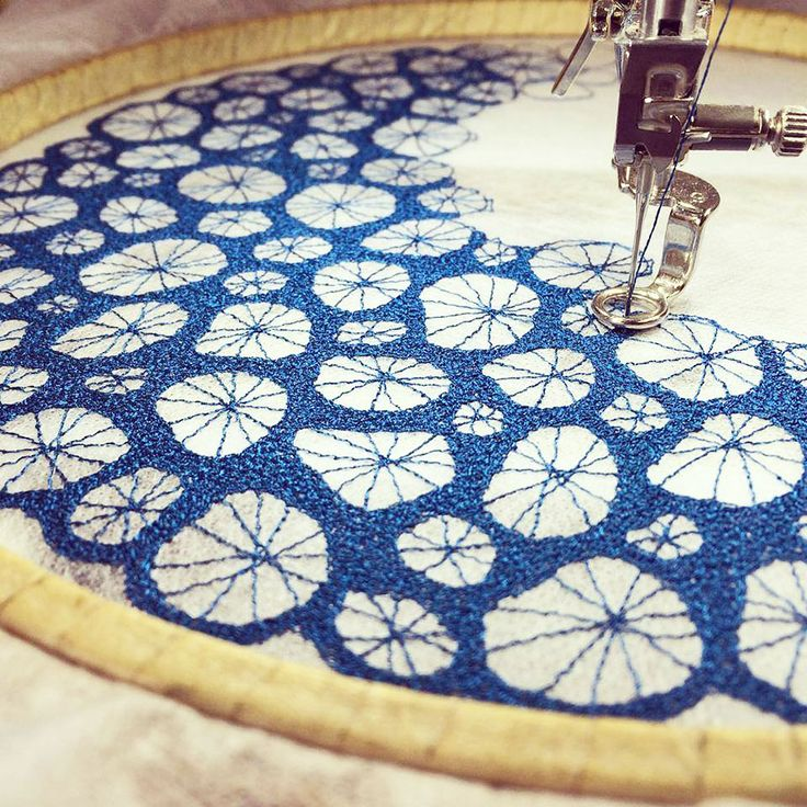 Meredith Woolnaugh - Australian who uses a domestic sewing machine and fabric base that dissolves in water to repeatedly stitch threads into dense structures that become 3-D sculptures.