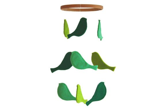 This is sooooo simple to make, and looks so neat! Easy to modify to match your room's color scheme too. (From http://www.etsy.com/listing/113557844/green-bird-crib-mobile-baby-crib-mobile)