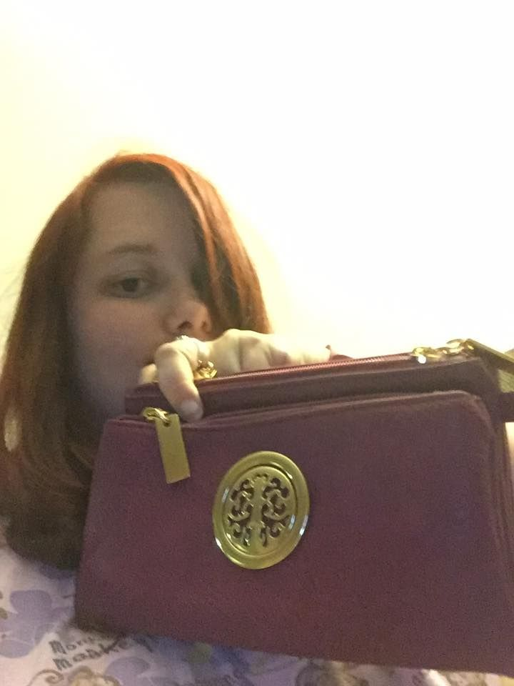 Samantha used 3 voucher bids to win this MKF wristlet for only $0.05! #QuiBidsWin