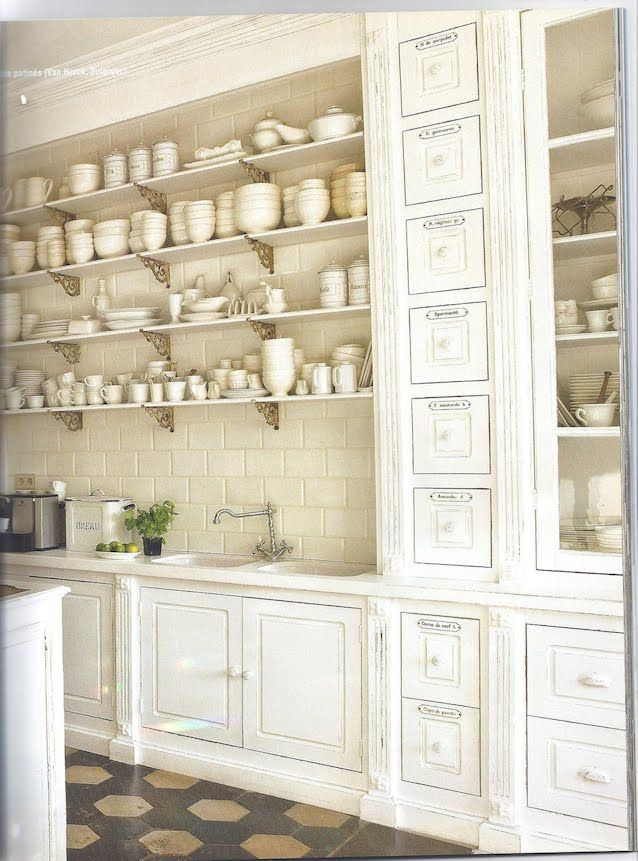 Inspiration for our old-house, DIY kitchen remodel… I love the idea of using salvaged or repurposed materials in place of a traditional kitchen cabinets.
