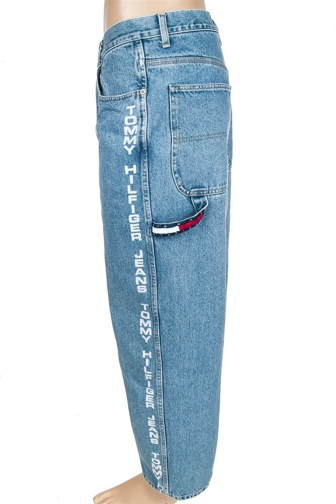 Tommy Hilfiger Jeans Denim with Hip Hop White Out Logo Letter. Circa 1990's. Displays the oversized pants trend that was common amongst rappers and singers and extremely different from the slim fit pants of a preppier Tommy Hilfiger we are accustomed to seeing.