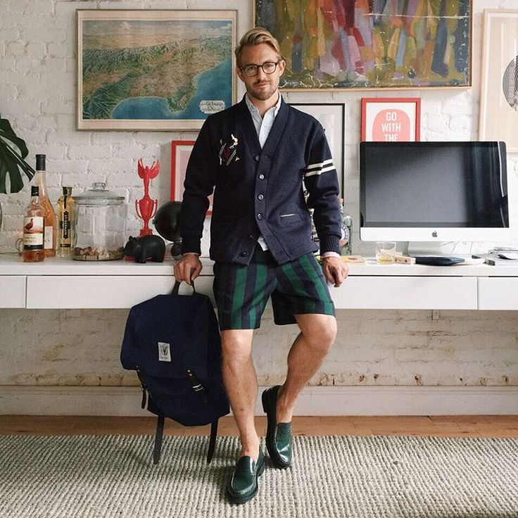 """Our Pinch Campus superlative winner of """"Most Likely to Build an Empire,"""" Patrick Janelle, has one buttoned up workspace. He wears his retro, green leather penny loafers for a relaxed office outfit."""