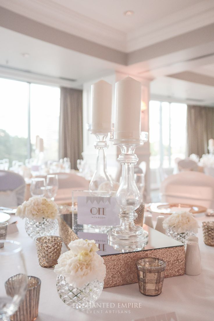 Set in the River Room of the Stamford Hotel Brisbane, this wedding was filled with classic romantic features. A gold and white colour palette set the scene with gold rimmed glass charger plates, pintuck napkins, elegant glass candlesticks and soft white florals in diamond cut votives, were used to bring soft romantic style to the tables. A subtle 1920s feel was added through the custom gold foiled printed menus, place cards, table numbers and seating chart. Wedding reception ideas.