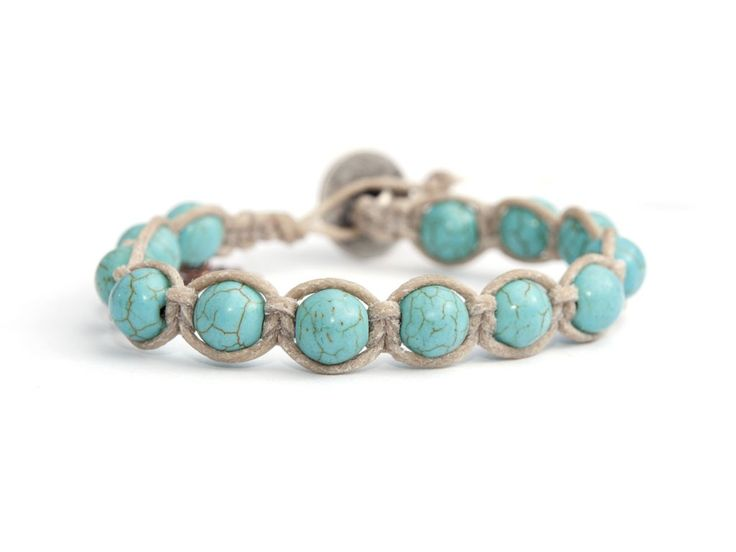 Turquoise Tibetan Bracelet For Man Reference:  5022  This is a handmade italian style man bracelet, BBHands Tibet Style. It is a wrap bracelet with charm. Precious stones (turquoise paste and tibetan silver button) are woven with care and passion onto a single braided waxed cord. This bracelet wraps around wrist 1 time and includes some adjustable leather closures for a confortable fit.It is 100% Made in Italy product.