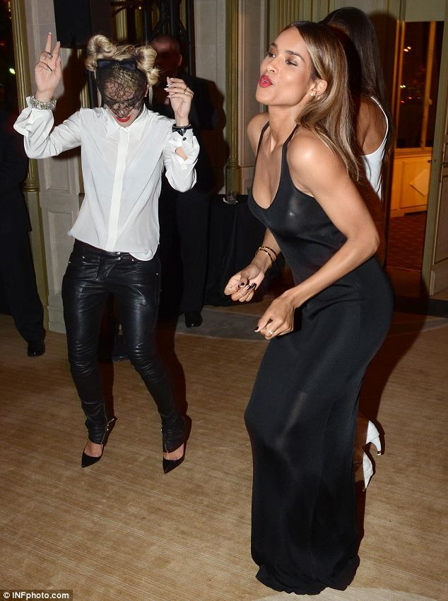 Rita Ora and singer-songwriter Ciara dance at the Mademoiselle C cocktail party