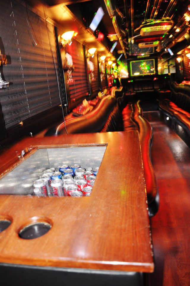Re-build at least one bench into an awesome cooler?   Interior of 50 Passenger Party Bus
