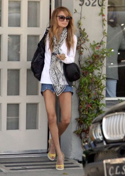 Jean shorts, white top, scarf.