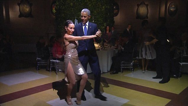 President Barack Obama shows off his dance moves with a professional tango dancer during his visit to Argentina.