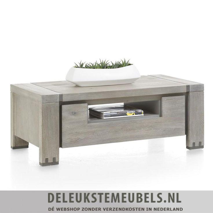 Deze stoere salontafel Avola van het merk Henders & Hazel is gemaakt van elm hout in de kleur stonegrey. Hij heeft een robuuste uitstraling. De salontafel heeft twee kleppen en een niche.Nog een leuk extraatje van deze salontafel is het optionele greepje. Ze worden standaard meegeleverd en je kunt zelf bepalen of je ze erop monteert.  Salontafel en andere meubels van het merk Henders & Hazel online kopen doe je snel en zonder verzendkosten bij deleukstemeubels.nl!
