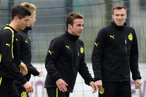 (L to R) Dortmund's Polish striker Robert Lewandowski, Dortmund's striker Marco Reus, Dortmund's midfielder Mario Goetze and Dortmund's midfielder Kevin Grosskreutz attend a training session in Dortmund, western Germany on April 23, 2013, on the eve of the UEFA Champions League football match against Real Madrid