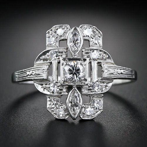 Art Deco Diamond Dinner Ring - cigar band style, platinum with diamonds including a pair of marquises. Transitional round brilliant 0.13 cts, SI1/H center stone; 2 marquise cuts 0.12 tcw, VS2-SI1/H-I. 12 single cut diamonds, 0.20 tcw, VS1/G. Circa 1930s