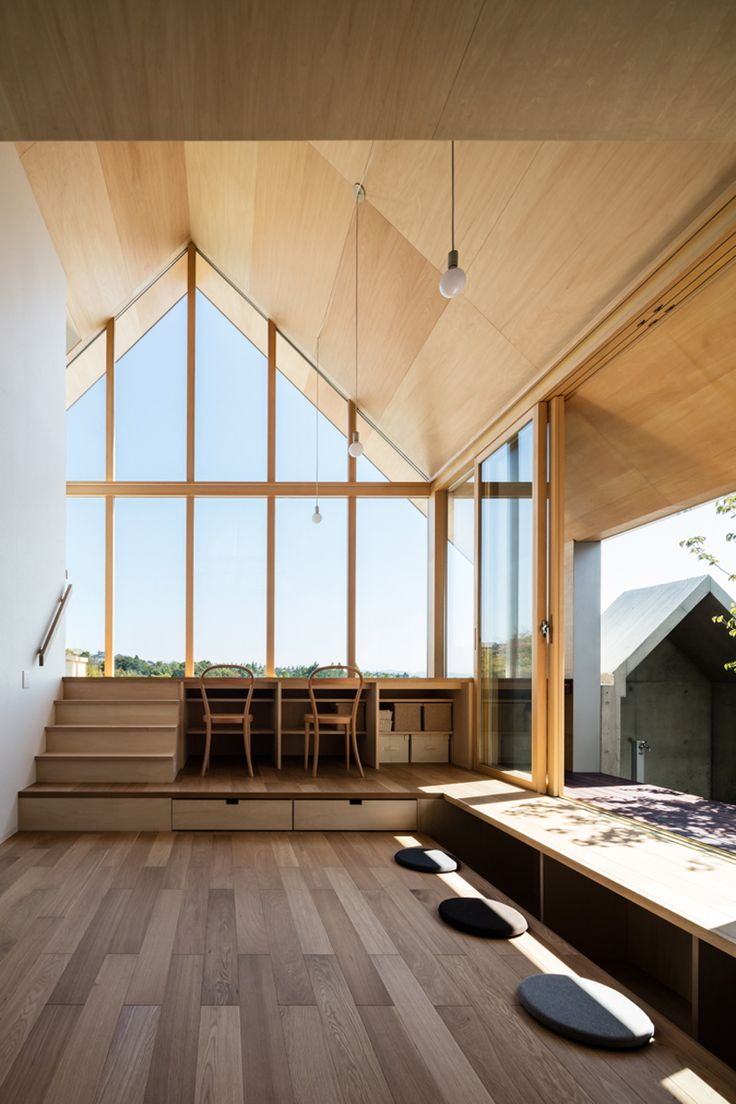 hiroto kawaguchi+kohei yukawa's wood-clad newtown house overlooks the picturesque japanese landscape
