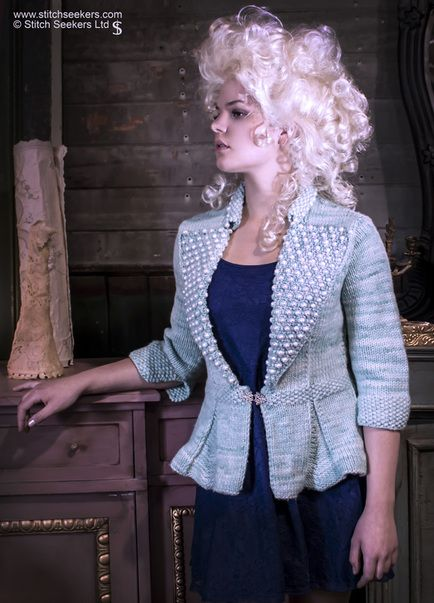 Eat Cake - a close fitting knitted jacket with flared peplum and elaborate pearl covered lapels.  www.stitchseekers.com #editionone