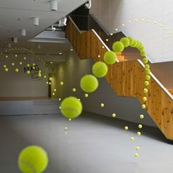 installation, one tennis ball  bouncing through time.