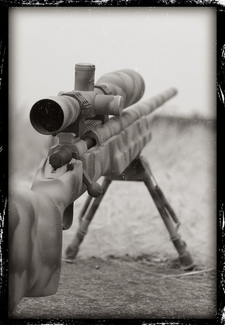 Distressed Photo of a bolt action rifle with Cerakote Firearm Coatings.