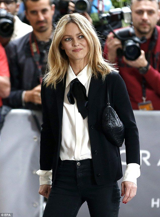 Vanessa Paradis oozed Parisian chic in a black and white ensemble which saw her team a black blazer with a white blouse and silk black pussy bow tie