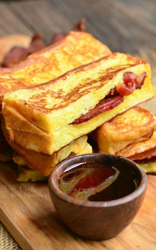 Out of this world delicious French Toast made from Brioche bread and stuffed with crispy bacon. This delicious breakfast is also made into easy-dippable sticks.