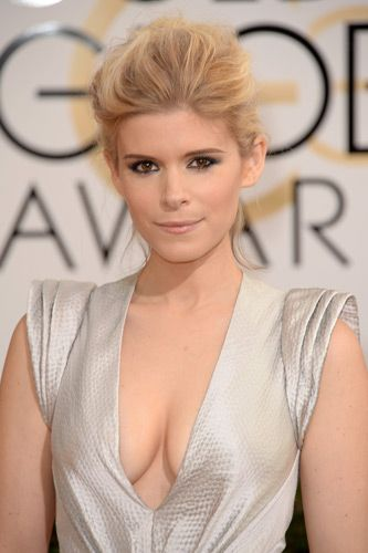 Kate Mara's lemon-frosting blonde hair pulled back into a soft, voluminous chignon mixed with edgy lining and glowing skin. #GoldenGlobes