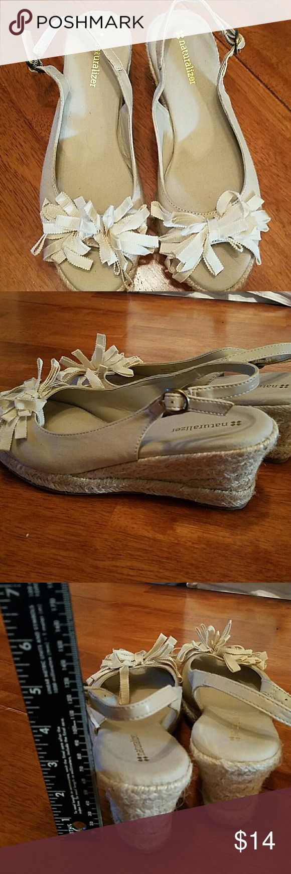 NATURALIZER LADIES  WEDGE SANDAL , LIKE NEW. SZ 7 Tan/ beige color, ladies Naturalizer wedge sandals in excellent condition with minimal wear. This neutral color would go with about anything. They are from a clean non-smoking home Naturalizer Shoes Sandals