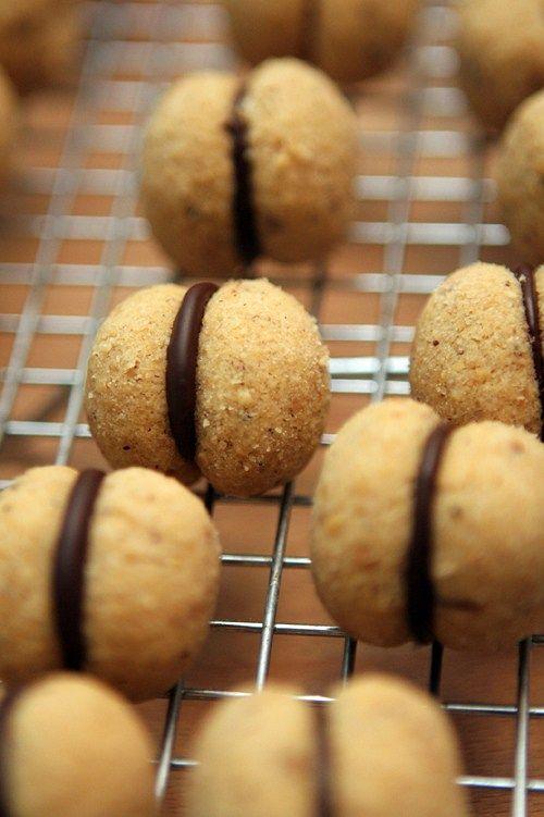 Baci di dama: Gluten-free Italian cookies. A rich, nutty dough filled with bittersweet chocolate!