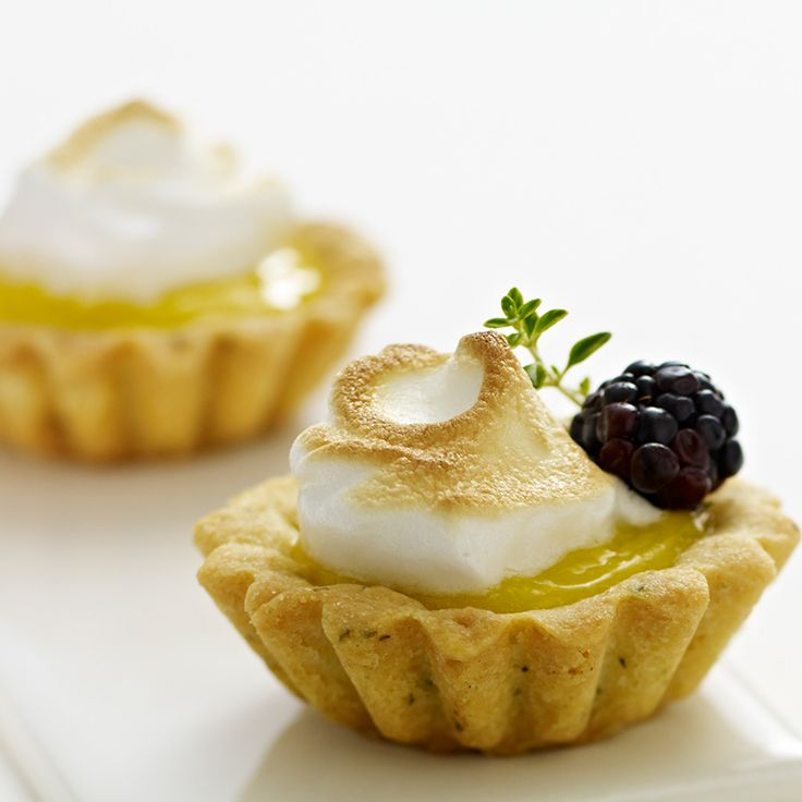 These individual Meyer lemon tartlets contain four layers of lemon flavor, from the lemon thyme crust to the lemon meringue kiss. The crust and lemon curd can be made a day ahead.