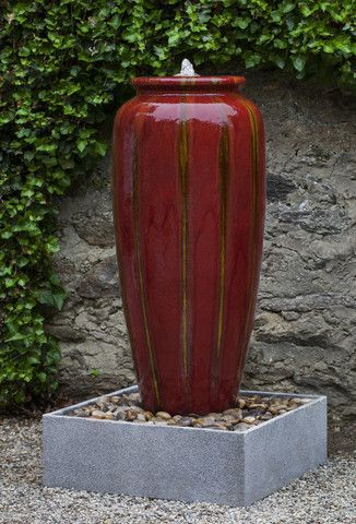 Beautiful reds adorn the VEGA JAR fountain. This glazed terra cotta water feature combines together with a lightweight fiberglass basin for the perfect water feature for any outdoor space.  Choose from a round or square basin.  The fiberglass basin can be used above or below ground Architectural Landscape Design